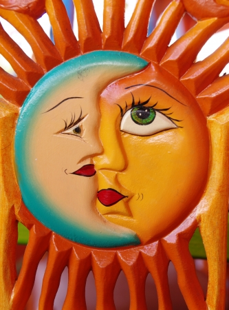 Mexican colorful carving of the sun and the moon in one photo