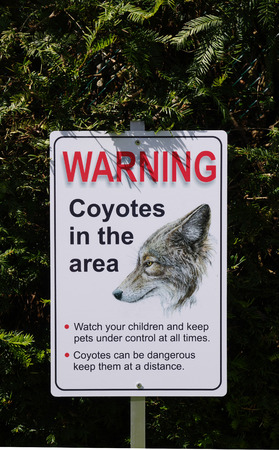 Coyotes in the Area warning sign photo