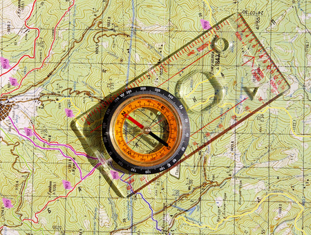 Walkers liquid-filled compass and on a topo map photo