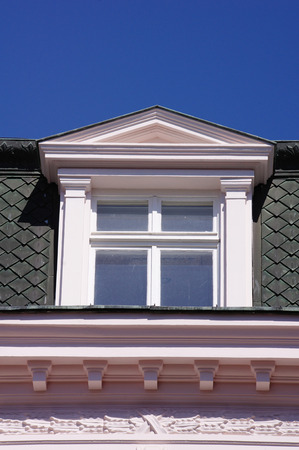 dormer: Close up view of old dormer window on the roof