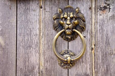 doorknocker: Lion head, Door knocker on old wooden door