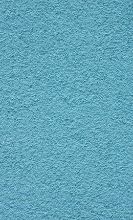 pices: New blue rough plaster on wall