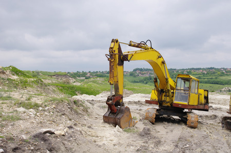 sand quarry: Old excavator in sand quarry in cloudy day Stock Photo