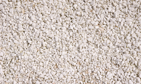 A texture of white gravel closeup in sunny day photo
