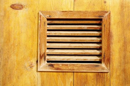 lattice window: Small window with wooden lattice closeup