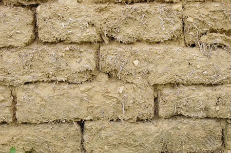 Old mud bricks wall closeup photo