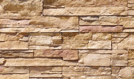 Cladding tiles imitating stones in sunny day photo