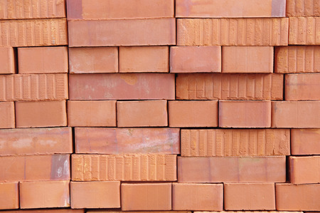 imperfection: Big pile of new bricks in sunny day Stock Photo