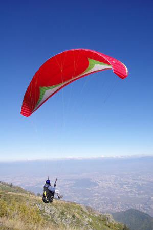 high flier: Paraglider in the sky over city Sofia, Bulgaria
