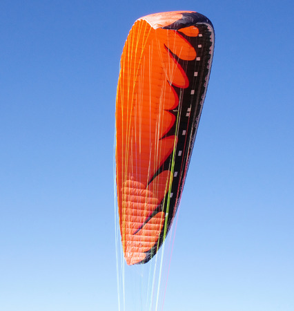 high flier: Red paraglider in the sky  in sunny day