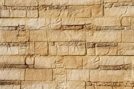 ecru: Decorative relief brown and ecru plaster imitating stone wall