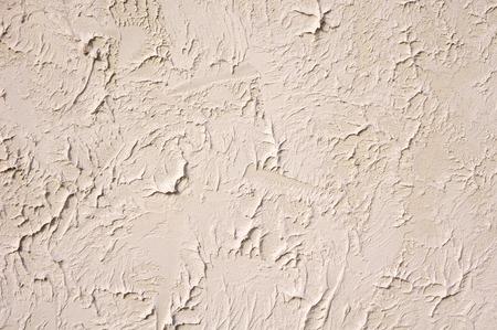 ecru: Decorative relief ecru plaster on wall  closeup
