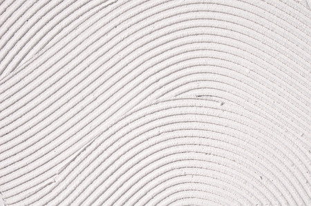 concave: White decorative relief plaster on wall closeup
