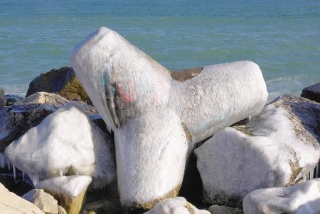 wintriness: Frozen tetrapod   in sunny winter day