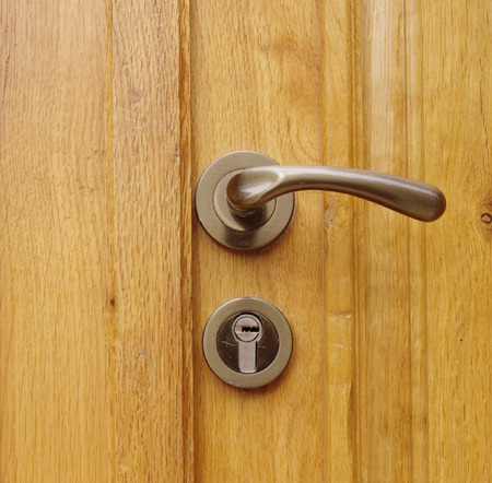 New wooden door with modern handle and lock photo