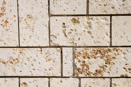 tile cladding: New stone cladding plates on  wall closeup