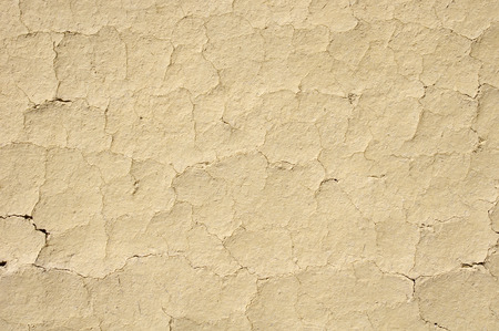 crannied: Cracked mud plaster wall closeup, Bulgaria Stock Photo