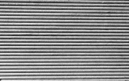grooves: Wooden grooves panel closeup in black and white Stock Photo