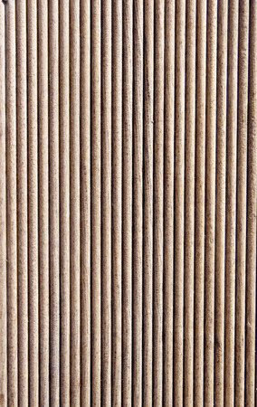 grooves: Wooden dark brown grooves panel closeup