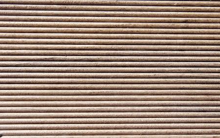 grooves: Wooden dark brown grooves panel closeup