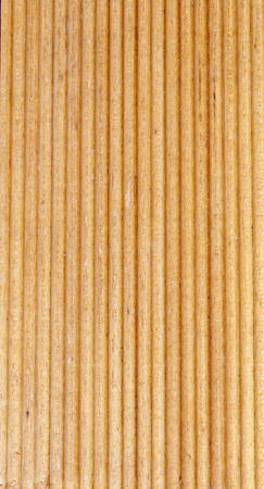 Wooden light brown grooves panel closeup