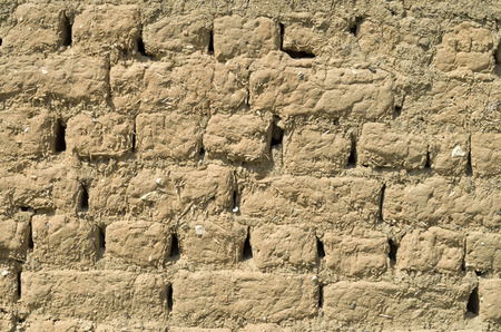 adobe: Old adobe wall closeup in sunny day