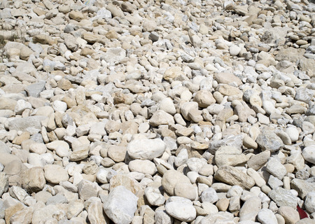rock bottom: Pile rounded stones on the beach  in sunny day Stock Photo