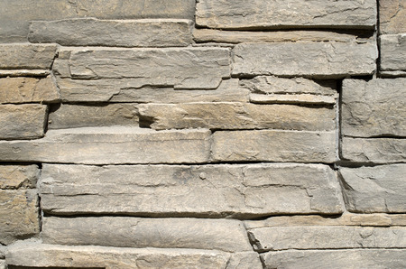 tile cladding: Cladding tiles imitating stones in sunny day
