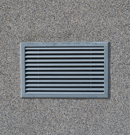 clean air: New air conditioning vent on wall closeup Stock Photo