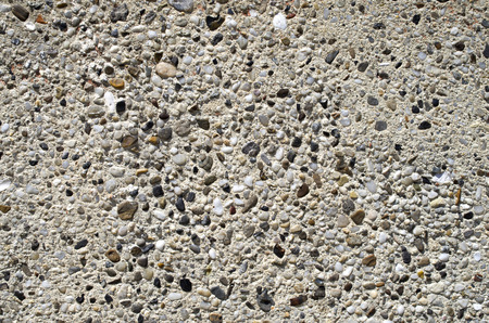 pebblestone: Plaster with mosaic of  pebbles on wall closeup Stock Photo