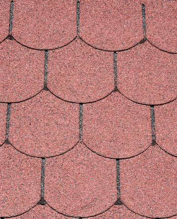 bitumen: Roof with red bitumen shingles closeup in sunny day