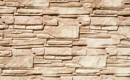 relief: Decorative relief cladding slabs imitating stones on wall closeup