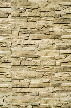 slabs: Decorative relief cladding slabs imitating stones on wall closeup