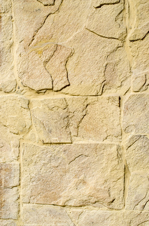yellow stone: Yellow stone cladding plates on the wall closeup Stock Photo