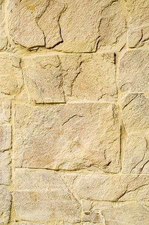 yellow stone: Yellow stone cladding plates on the wall closeup Foto de archivo