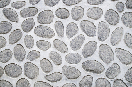 rounded: A wall of large rounded boulders with white joints closeup