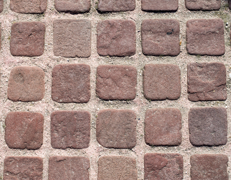 pavers: Small brown pavers with pink joints closeup