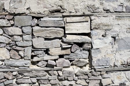 walled: Old stone wall with walled window closeup  in sunny day