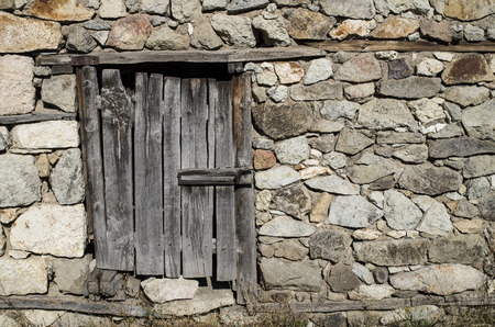 padlocked: Old stone wall with wooden padlocked door , Bulgaria