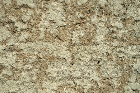 plastered: Wall plastered with mud and straw closeup Stock Photo