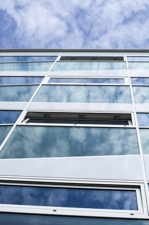 reflecting: New glass building with reflecting clouds, Bulgaria