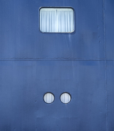sidelight: Various illuminator of navy cruise ship closeup