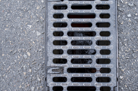grate: Trench drain linear grate on street closeup