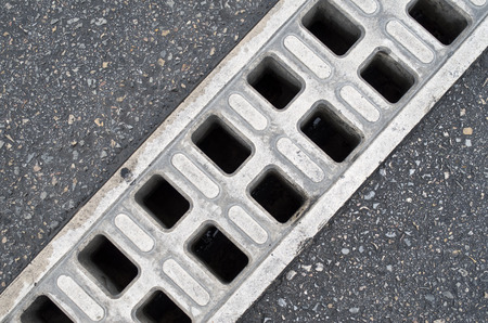 Trench drain linear grate on street closeup