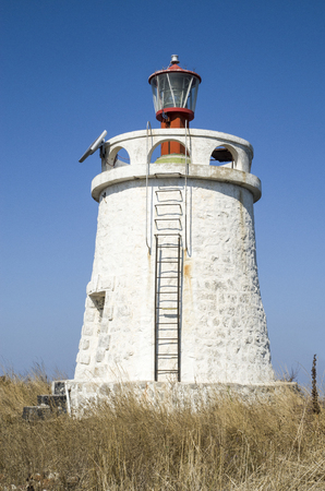 maslen: White old stone lighthouse on Maslen nos, near Primorsko, Bulgaria
