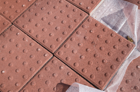convexity: New heap of red paving for the blind closeup Stock Photo