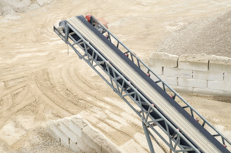 classifier: Belt conveyor in Gravel Quarry in cloudy day Stock Photo