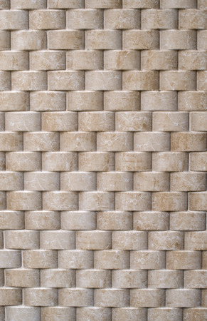 tile cladding: Decorative relief cladding slabs imitating cylinders on wall closeup