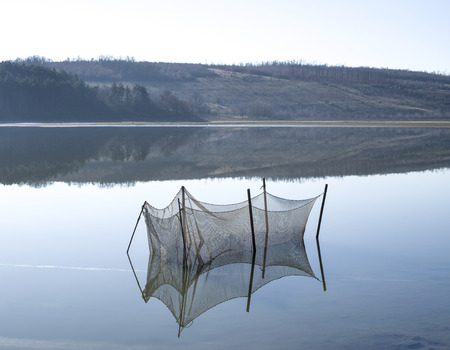 fish breeding: Breeding pond for fish in the lake with reflection