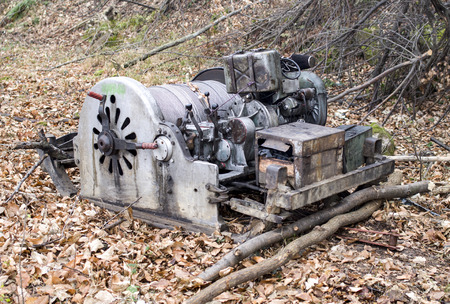 windlass: Old diesel portable winch for the transportation of felled trees